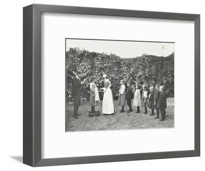 Children Being Weighed in the Garden, Montpelier House Open Air School, London, 1908--Framed Photographic Print