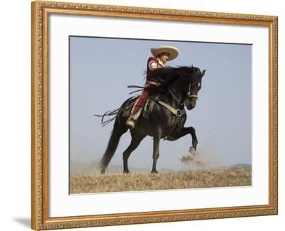 Charro on a Black Andalusian Stallion Galloping in Ojai, California, USA-Carol Walker-Framed Photographic Print