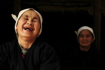 Two Dong Women, One Laughing, in a Dark Room, Sanjiang Dong Village, Guangxi, China-Enrique Lopez-Tapia-Framed Photographic Print
