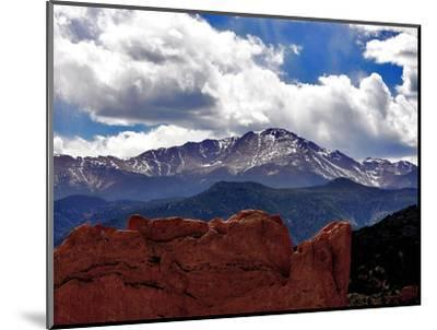 The Sun Breaks Through the Clouds to Highlight the Summit of Pikes Peak--Mounted Photographic Print
