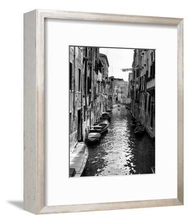 Lines of Laundry Hang Between Residential Buildings--Framed Photographic Print