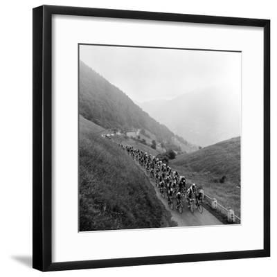 Contestants in the Grueling Tour De France are Seen on Their Way to the Mente Pass--Framed Photographic Print
