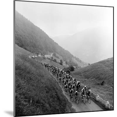 Contestants in the Grueling Tour De France are Seen on Their Way to the Mente Pass--Mounted Photographic Print