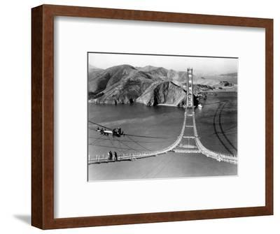 Workers Complete the Catwalks for the Golden Gate Bridge--Framed Photographic Print