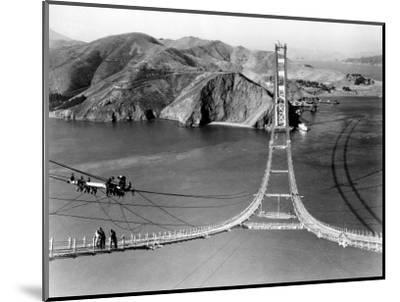Workers Complete the Catwalks for the Golden Gate Bridge--Mounted Photographic Print