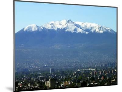 The Ajusco Mountain is Seen Behind Mexico City--Mounted Photographic Print