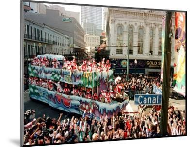 Mardi Gras Revellers Greet a Float from the Zulu Parade--Mounted Photographic Print