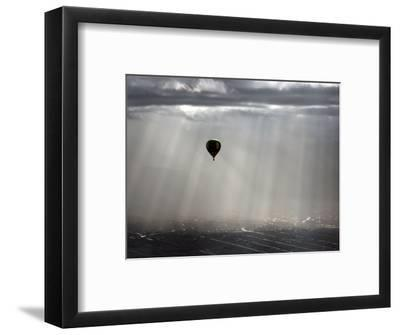 A Lone Balloon Drifts Near the Foothills of Albuquerque, N.M.--Framed Photographic Print