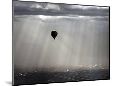 A Lone Balloon Drifts Near the Foothills of Albuquerque, N.M.--Mounted Photographic Print