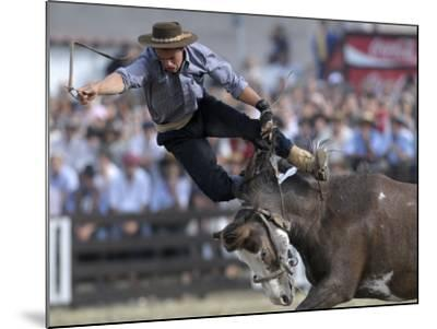 Gaucho, or Cowboy, is Thrown from a Horse as He Competes in a Rodeo in Montevideo--Mounted Photographic Print