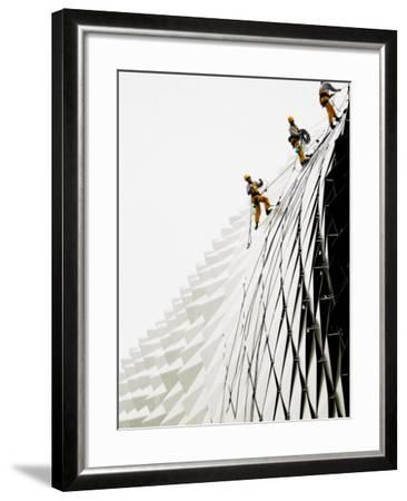 Workers Climb Down the Roof of Singapore's Spikey Fruit Shaped Esplanade Arts Center--Framed Photographic Print