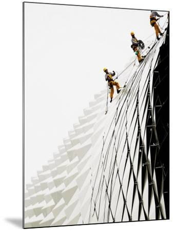 Workers Climb Down the Roof of Singapore's Spikey Fruit Shaped Esplanade Arts Center--Mounted Photographic Print