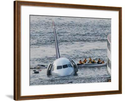 Passengers in a Raft Move from an Airbus 320 US Aircraft That Has Gone Down in the Hudson River--Framed Photographic Print