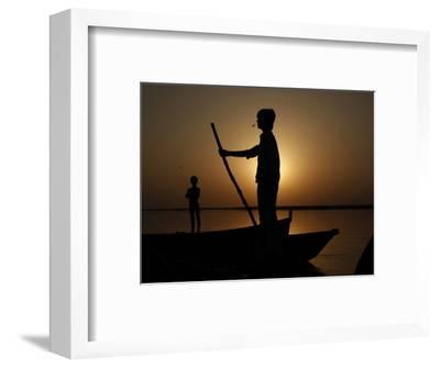Boatman Prepares to Anchor His Boat, after the Day's Work in River Ganges, in Allahabad, India--Framed Photographic Print