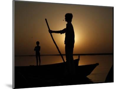 Boatman Prepares to Anchor His Boat, after the Day's Work in River Ganges, in Allahabad, India--Mounted Photographic Print
