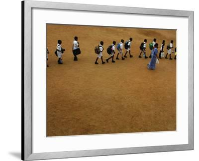 Children Follow Their Teacher as They Head Back to School for the First Time after the Tsunami--Framed Photographic Print