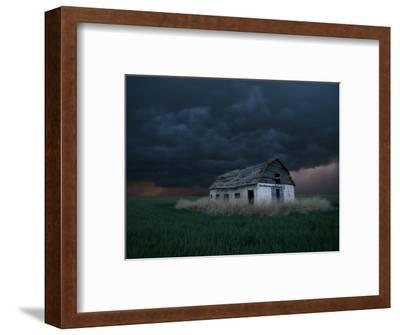 Old Barn Stands in a Wheat Field as a Thunderstorm Passes in the Distance Near Ogallah, Kansas--Framed Photographic Print