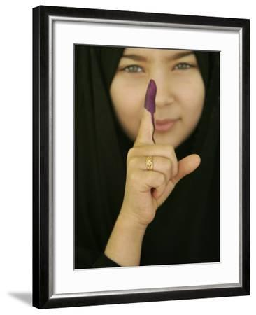 Young Girl Shows Her Inked Finger, Even Though She Was Too Young to Vote, in Karbala, Iraq--Framed Photographic Print