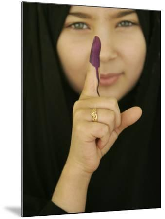 Young Girl Shows Her Inked Finger, Even Though She Was Too Young to Vote, in Karbala, Iraq--Mounted Photographic Print