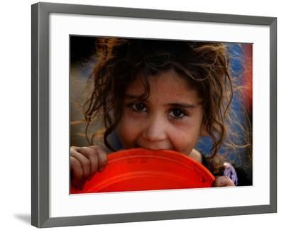 Afghan Refugee Child Who Lives in Slum Area of Lahore City in Pakistan Waits to Get Water--Framed Photographic Print