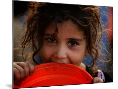 Afghan Refugee Child Who Lives in Slum Area of Lahore City in Pakistan Waits to Get Water--Mounted Photographic Print