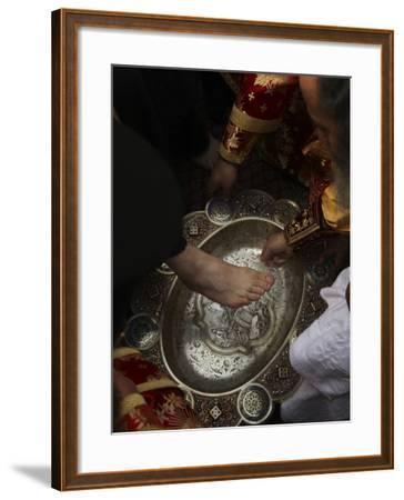 Greek Orthodox Patriarch Washes Foot of Priest at Ceremony Outside Church of Holy Sepulchre--Framed Photographic Print