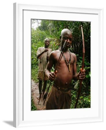 Pygmy Young Men Armed with Bows and Arrows Hunt--Framed Photographic Print
