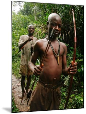 Pygmy Young Men Armed with Bows and Arrows Hunt--Mounted Photographic Print