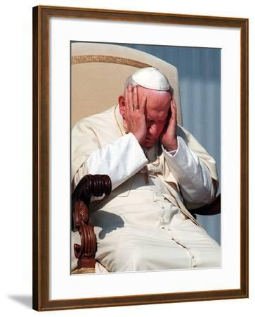Pope John Paul II Holds His Head During the Weekly Open-Air General Audience--Framed Photographic Print