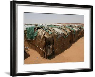 Two Sudanese Boys Stand by Makeshift Huts--Framed Photographic Print