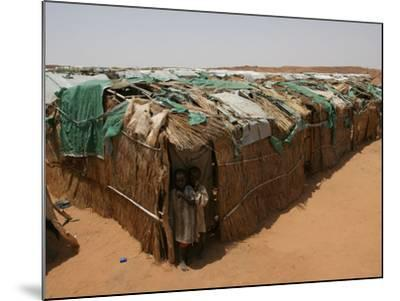 Two Sudanese Boys Stand by Makeshift Huts--Mounted Photographic Print
