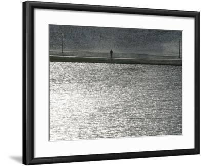 A Man Stands on the Banks of a Small Lake, Munich, on Friday, November 3, 2006.-Christof Stache-Framed Photographic Print