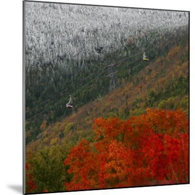 Tram Cars Take Tourists Up Cannon Mountain in New Hampshire as Snow Meets with Changing Leaves--Mounted Photographic Print