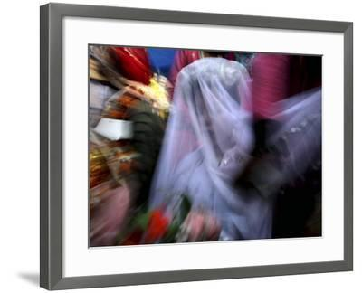 Bride Sits Next to Groom During a Mass Marriage Ceremony for About 50 Couples in Amritsar, India--Framed Photographic Print