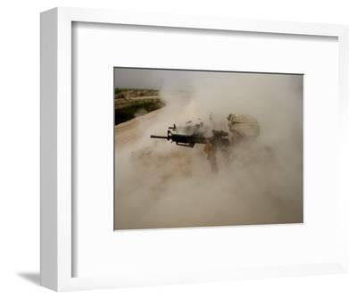 US Marines Return Fire on Taliban Positions Near the Town of Garmser in Afghanistan--Framed Photographic Print