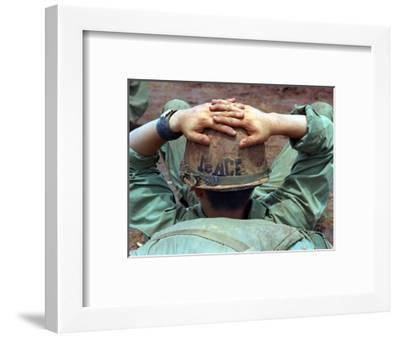 Peace Helmet-Associated Press-Framed Photographic Print