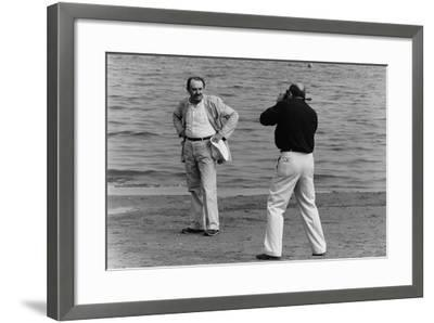 Tonino Guerra Poses before a Photographer at the Seaside--Framed Photographic Print