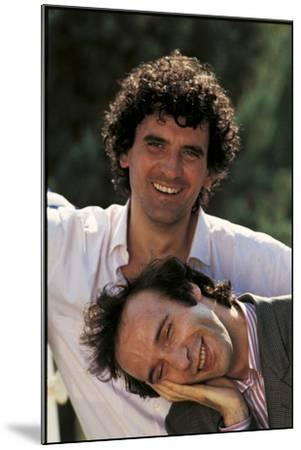 Portrait of Roberto Benigni and Massimo Troisi Smiling--Mounted Photographic Print