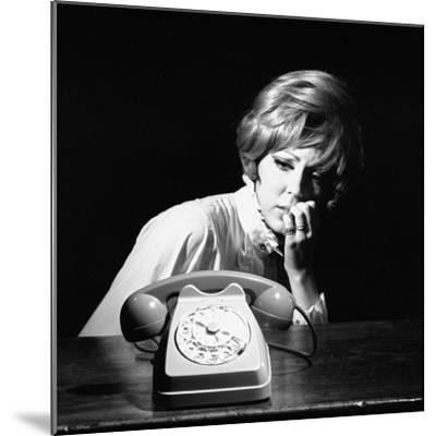 A Woman Looking at a Phone-Marisa Rastellini-Mounted Photographic Print