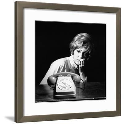 A Woman Looking at a Phone-Marisa Rastellini-Framed Photographic Print