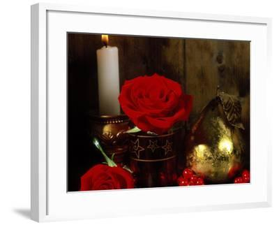 Lit White Candle in Gold Holder with Two Red Roses, Ilex Berries & Gold Pear Christmas Ornament-James Guilliam-Framed Photographic Print