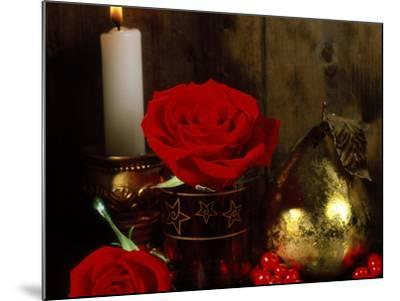 Lit White Candle in Gold Holder with Two Red Roses, Ilex Berries & Gold Pear Christmas Ornament-James Guilliam-Mounted Photographic Print
