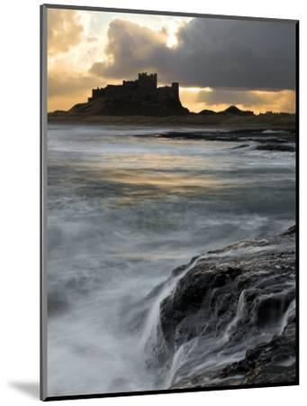 View of Bamburgh Castle at Sunset, UK-David Clapp-Mounted Photographic Print