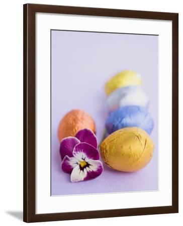 Chocolate Eggs in Foil, with Pansy--Framed Photographic Print