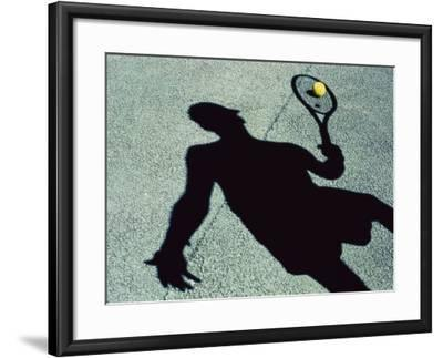 Shadow of a Male Tennis Player Playing Tennis--Framed Photographic Print