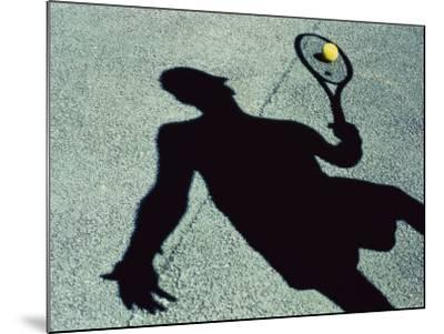 Shadow of a Male Tennis Player Playing Tennis--Mounted Photographic Print