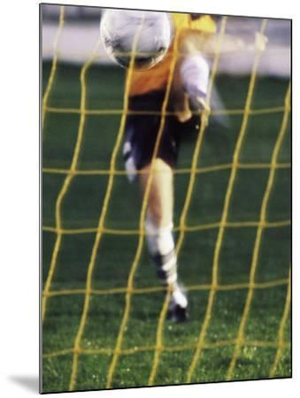 Soccer Player Kicking a Soccer Ball--Mounted Photographic Print