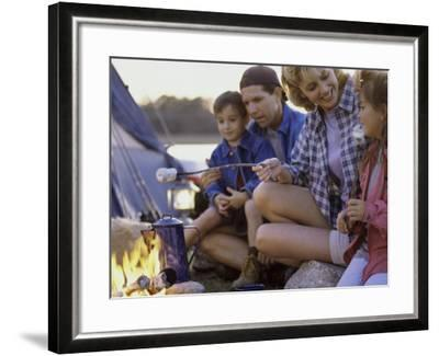 Parents And Their Children Sitting Around a Campfire Toasting Marshmallows--Framed Photographic Print