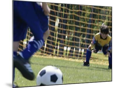 Goalie Attempting to Stop a Soccer Ball--Mounted Photographic Print