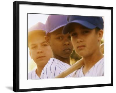 Portrait of Three Boys in Full Baseball Uniforms--Framed Photographic Print